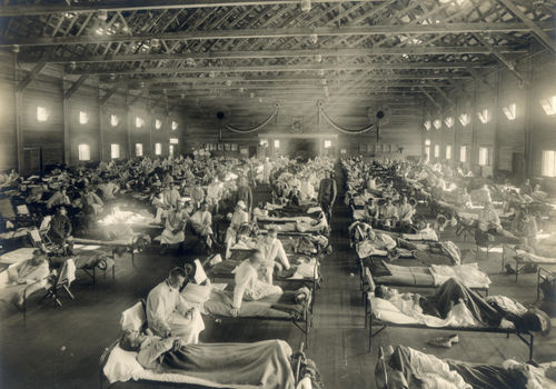 oldiers from Fort Riley, Kansas, ill with Spanish flu at a hospital ward at Camp Funston. (Source: Otis Historical Archives, National Museum of Health and Medicine, OHA 250)